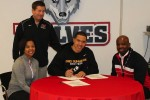 Senior Nick Johnson signs a letter of intent with Ohio Dominican University Wednesday, Feb. 5. Photo courtesy of the athletic department.