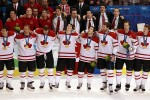 Team Canada hockey player stand together during the national anthem after receiving their gold medals for defeating the USA in overtime, 3-2, in the men's hockey final at Canada Hockey Place in Vancouver, Canada, Sunday, February 28, 2010. (Nuccio DiNuzzo/Chicago Tribune/MCT)