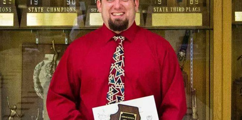 Adrian Batista receives Illinois Coach of the Year