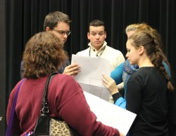 Director Andy Sinclair discusses last-minute changes with the crew at the final practice Thursday, Dec. 12. Photo by Katrina Nickell