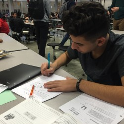 Joey Guliana, a senior student athlete, works on his anatomy homework during the last couple minutes of the period. Guliana and other students are preparing for final exams, which take place Dec. 16-18. Photo by Kevin Sanchez