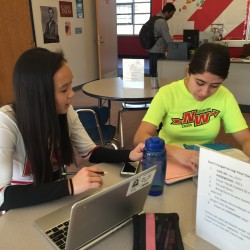 Junior Amanda Lee tutors junior Sam Aessa on math during 9th period on Friday, Dec. 4. Photo by Grace Geraghty