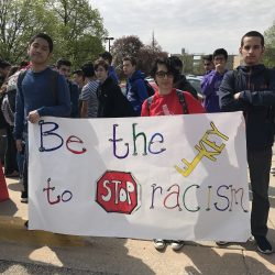 Students stand against racism Friday, April 27. Photo by Isa Gil